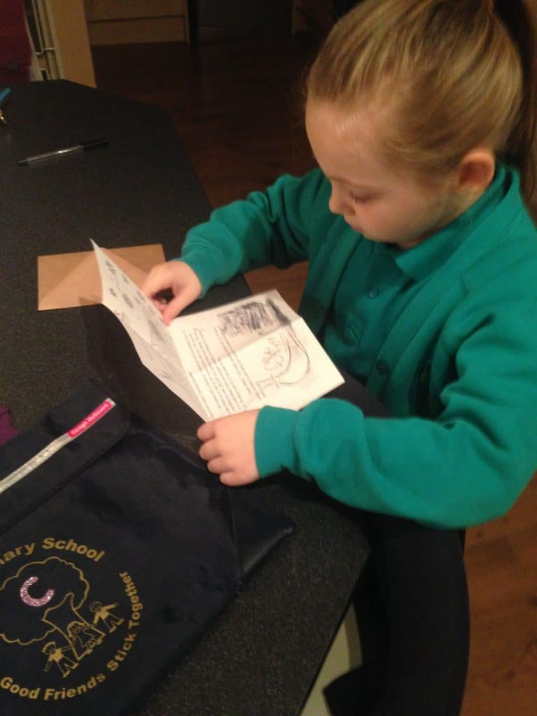 Reading hand-drawn Elfie's Christmas Letters, delivered by the International Elf Service before school!