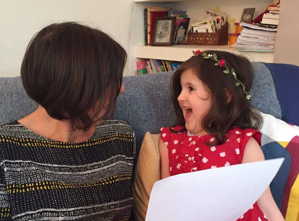 Mama and daughter enjoy reading their news from the North Pole together. Personalised Christmas Elf Letters from the International Elf Service